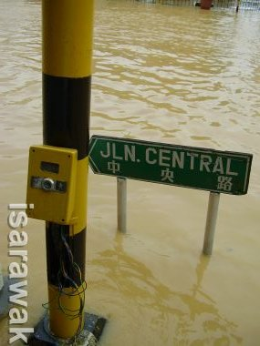 traffic light pole surrounded by flood